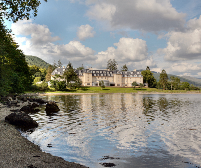 The Ardgartan hotel, overlooking a loch and surrounded by a forest