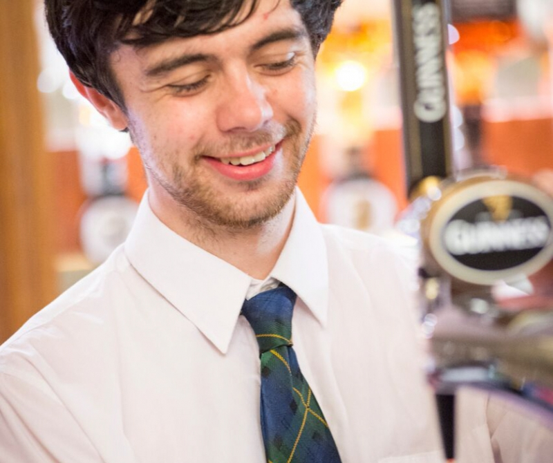 Lochs & Glens Bar Tender Pouring a pint at one of our highland loch hotels