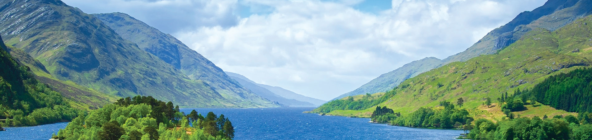 Gazing across a gorgeous loch enjoying a coach tour with Lochs and Glens